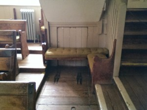 Quaker Meeting House: Bench Under Stairs